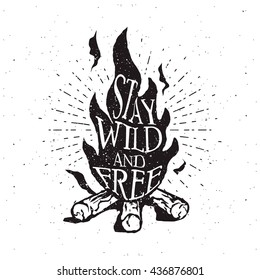 Hand drawn campfire typography badge. Stay wild and free quote. Outdoor camping themed print for t-shirt, vector