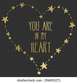 """Hand drawn card with gold foil heart. For wedding, Valentine's Day, and declaration of love. """"You are in my heart"""" lettering. Black background."""
