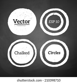 Hand drawn chalked circles and rings on blackboard background. Vector set