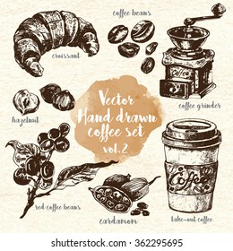 Hand Drawn Coffee Set vol.2.  Including take-out coffee, croissant, retro coffee grinder, hazelnut, cardamom, beans and raw coffee. Design elements for restaurants and menus. Ink drawn vintage style.