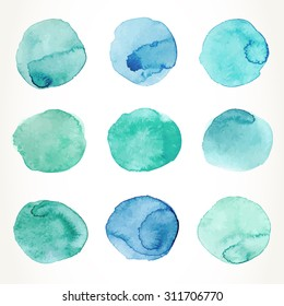 Hand drawn colorful blue and green watercolor circles, isolated over white.