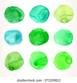 Hand drawn colorful green watercolor circles, isolated over white.