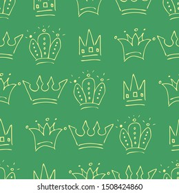 Hand drawn crowns. Seamless pattern of simple graffiti sketch queen or king crowns. Royal imperial coronation and monarch symbols. Yellow doodle isolated on green background. Vector illustration.