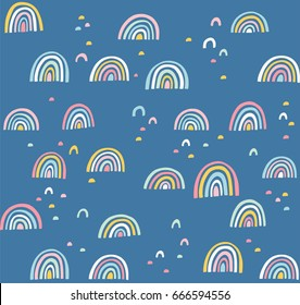 Hand drawn cute abstract pattern. Rainbow doodle vector seamless background. Design for fabric.