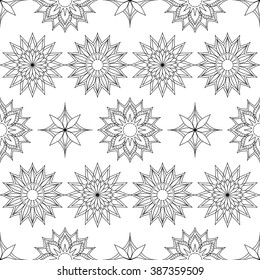 Hand drawn decorated seamless pattern in boho style with mandalas.  Monochrome image. Vector illustration - eps 10.