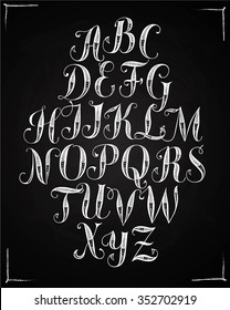Hand drawn decorative calligraphy vector ABC letters with floral ornament. Beautiful font on blackboard background for your design.