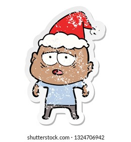 hand drawn distressed sticker cartoon of a tired bald man wearing santa hat