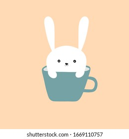 Hand drawn doodle cute kawaii white Easter bunny with funny face expression sitting in blue coffee tea mug on pastel pink background. Holiday greeting card kids room nursery wall art