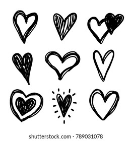 Hand drawn doodle vector hearts set