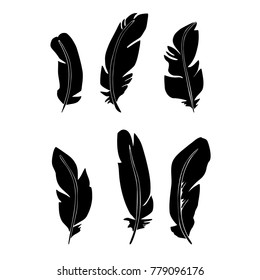 Hand drawn feathers. Black feather silhouettes isolated on white background. Graphic vector illustration
