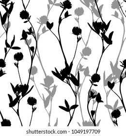 Hand drawn floral seamless pattern with clover silhouettes isolated on white. Cute graphic flower background. Summer concept. Design element for textile, fabrics, scrapbooking, wallpaper and etc. Vect