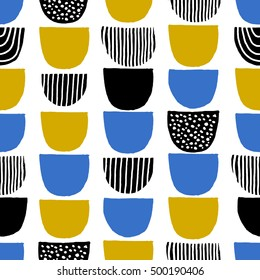 Hand drawn geometric shapes seamless repeating pattern in black, blue, mustard yellow and white.