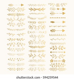 Hand drawn golden text dividers. Line borders and laurel design elements. Foil arrows. Vector. Isolated