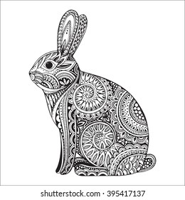 Hand drawn graphic ornate rabbit with ethnic floral doodle pattern.Vector illustration for coloring book, tattoo, print on t-shirt, bag. Isolated on a white background.