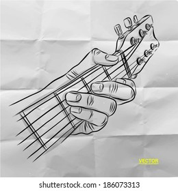 hand drawn of had playing guitar on crumpled paper background