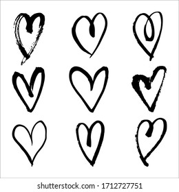 Hand drawn heart outline set.  Rough grungy brush strokes scribble. Simple cute love and romantic icons. Abstract doodle heart shapes trendy minimal sketch.