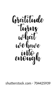 Hand drawn holiday lettering. Ink illustration. Modern brush calligraphy. Isolated on white background. Gratitude turns what we have into enough.