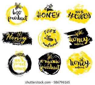 Hand drawn honey logo with bees and modern ink lettering. Handwritten brush style modern calligraphy