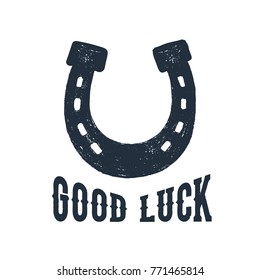 "Hand drawn horseshoe textured vector illustration and ""Good luck"" inspirational lettering."