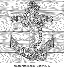 Hand drawn illustration of an anchor and rope in the zentangle style. Adult coloring page. Vector illustration.