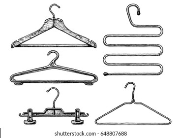hand drawn illustration of clothes coat-hanger set in vintage engraved style. Wooden, plastic and wire coathangers, clamp for the hanging of trousers, 5-level coat hanger. on white background.