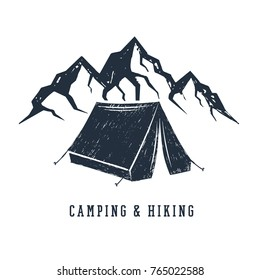 """Hand drawn inspirational label with mountains and camping tent textured vector illustrations and """"Camping and hiking"""" lettering."""