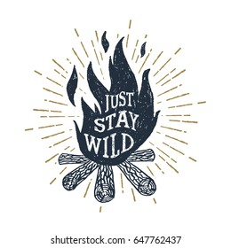 "Hand drawn inspirational label with textured bonfire vector illustration and ""Just stay wild"" lettering."