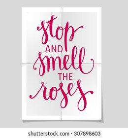 "Hand drawn inspirational quote ""Stop and Smell the Roses"" on poster background. Brush painted letters. Vector illustration."