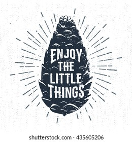 """Hand drawn label with textured pine cone vector illustration and """"Enjoy the little things"""" lettering."""