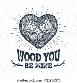 "Hand drawn label with textured tree trunk vector illustration and ""Wood you be mine?"" lettering."