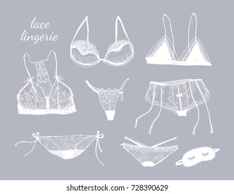 Hand drawn lace lingerie. Graphic vector set. White elements, grey background. All elements are isolated