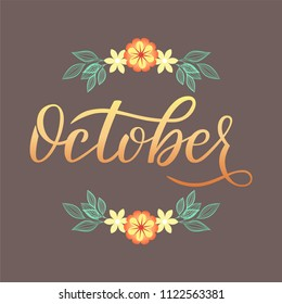 Hand drawn lettering with phrase October. Isolated text on a dark brown background with a wreath.