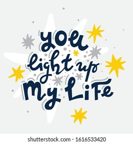 """Hand drawn lettering phrase """"You light up my life"""". Greeting card template for St. Valentines Day romantic vector illustration."""