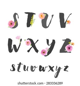 Hand drawn letters written with brush pen. Letters are decorated with watercolor flowers. Capital letters.