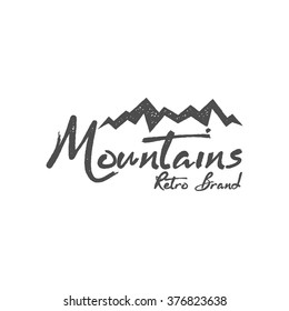 Hand drawn mountain badge. Wilderness old style typography print, web label. Letterpress Print Rubber Stamp Effect. Retro logo design. vector Inspirational vintage hipster brand design.