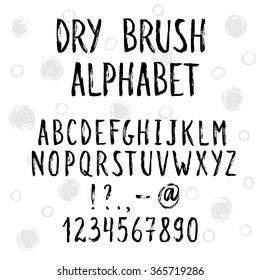 Hand drawn narrow and tall letters.  Dry brush handwritten alphabet with sketch circles on background. Modern ink typography.