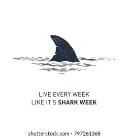 "Hand drawn nautical badge with shark's fin textured vector illustration and ""Live every week like it's shark week"" lettering."