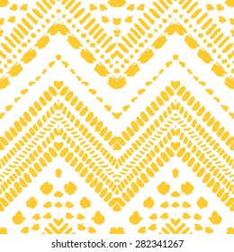 Hand drawn painted seamless pattern. Vector illustration for tribal design. Ethnic motif. Zigzag and stripe line. Yellow and white colors. For invitation, web, textile, wallpaper, wrapping paper.