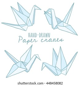 Hand drawn paper crane. Origami vector set