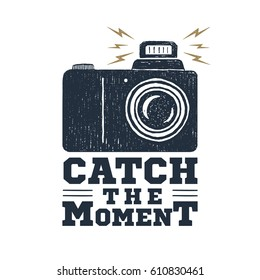 "Hand drawn party label with photo camera textured vector illustration and ""Catch the moment"" inspirational lettering."
