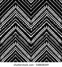 Hand drawn pattern. Zigzag and stripe line. Vector illustration for tribal design. Black and white colors. For textile, wallpaper, wrapping paper. Ethnic theme