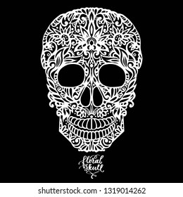 Hand drawn patterned skull, decorative silhouette white on black