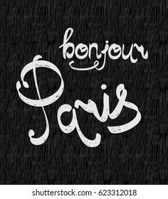 Hand drawn phrase Bonjour Paris. Isolated on black background.