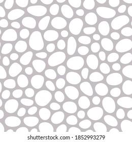 Hand drawn polka dot seamless pattern. Random geometric pebble wallpaper. Simple stones backdrop. Design for fabric, wrapping paper. Vector illustration