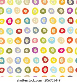 Hand drawn primitive seamless pattern with abstract circles in bright colors