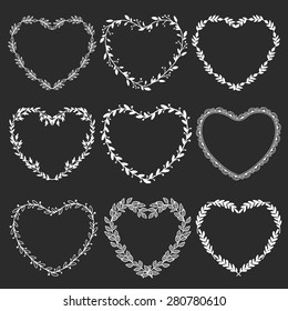 Hand drawn rustic vintage heart wreaths on blackboard. Floral vector graphic. Nature design elements