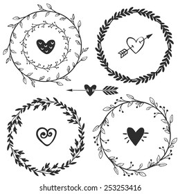 Hand drawn rustic vintage wreaths with hearts. Floral vector graphic. Nature design elements