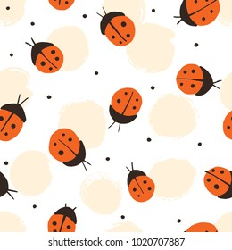 Hand drawn. Seamless pattern with cartoon ladybirds.