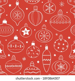 Hand drawn seamless pattern with cute hand drawn Christmas tree decorations, baubles. Repetitive New Year baubles print. Vector design in black and white.