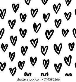 Hand drawn seamless pattern with doodle heart shapes. Ink illustration.